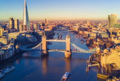 Aerial view of London Bridge with high rise buildings and a river.