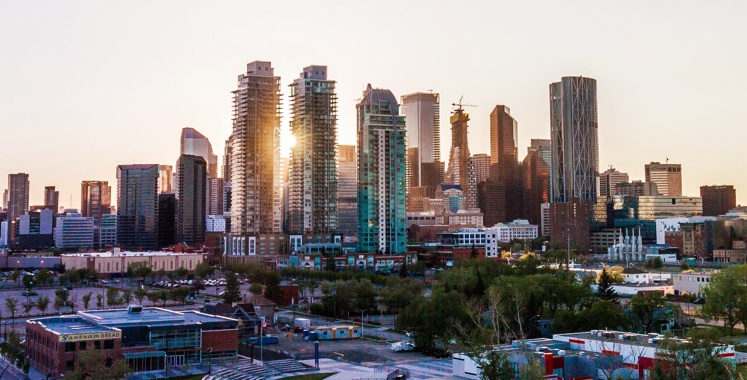 Sun coming through the skyscrapers in Calgary