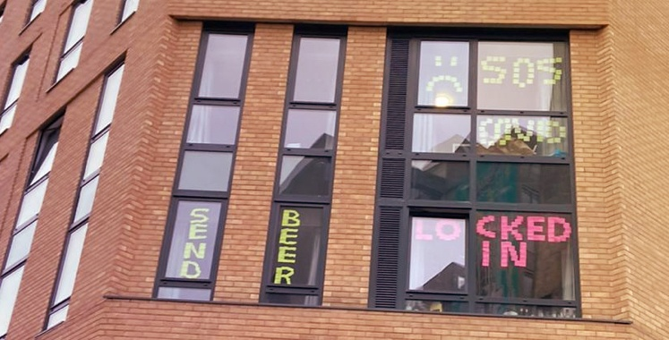 Bristol University 2020 with signs of students asking for help in the windows