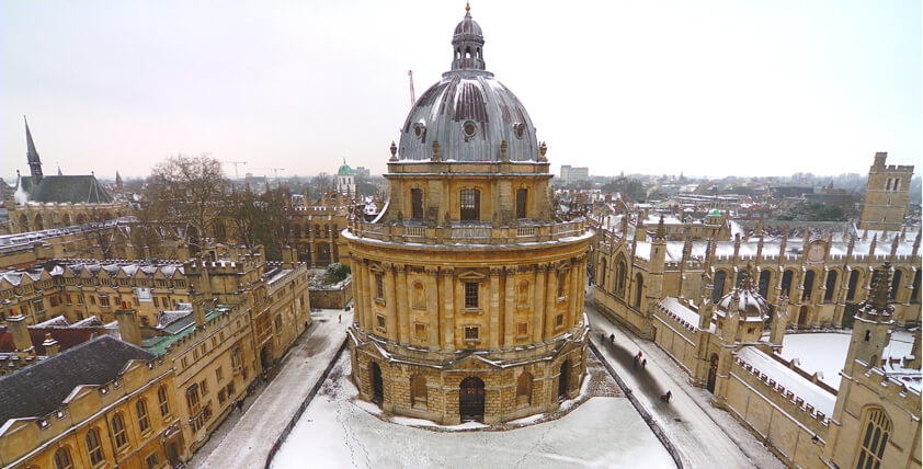 Oxford University building with snow