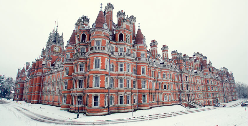 Chateaux inspired Royal Holloway University building in the snow