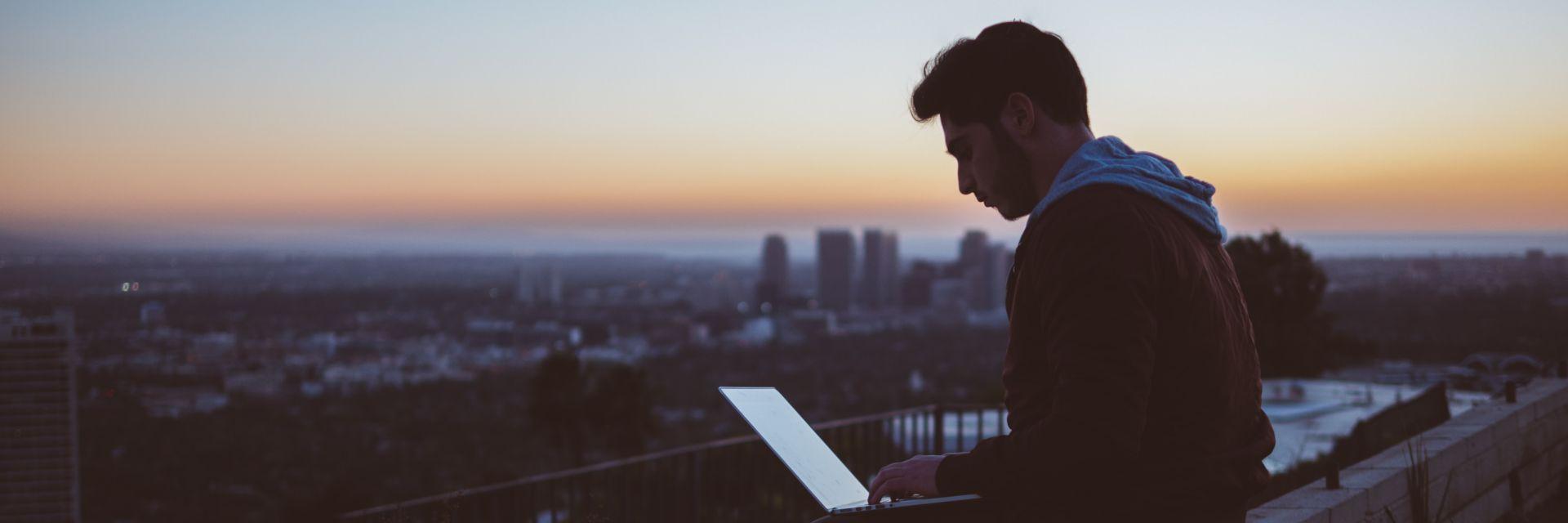 Man sitting looking at laptop